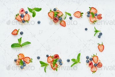 Rise crispbread frame with berries and fruits colorful concept on pastel background copy space