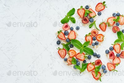 Rise crispbread with berries and fruits colorful concept on pastel background copy space top view