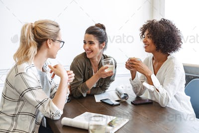 Group of cheerful young women studying together
