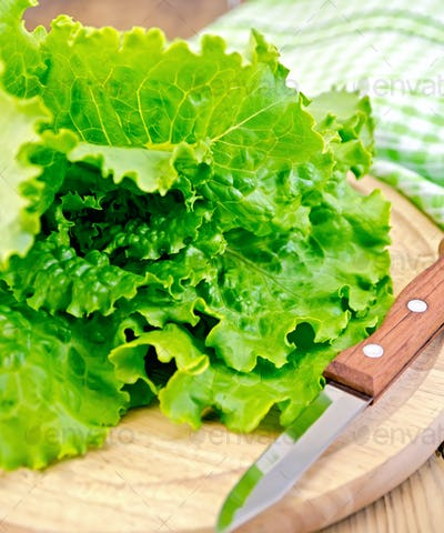 Lettuce green with a knife on board