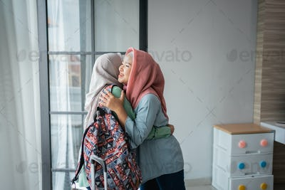 Asian hijab young women are happy to meet their mother