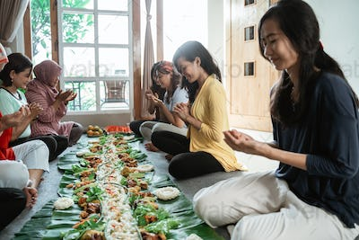 diverse religion friends eating together at home