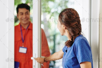 Woman letting in service worker