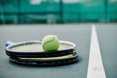 Two rackets and tennis ball