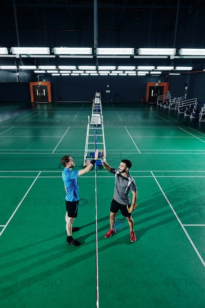 Badminton players giving hign five