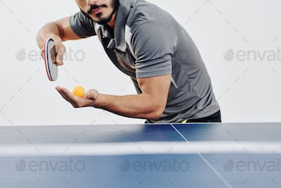 Ping pong player serving ball