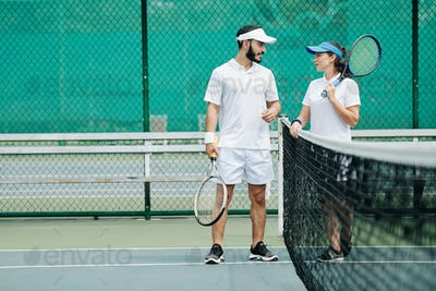 Couple plying tennis