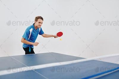 Sportsman playing table tennis