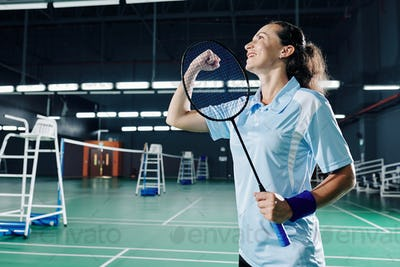 Female badminton player celebrating victory