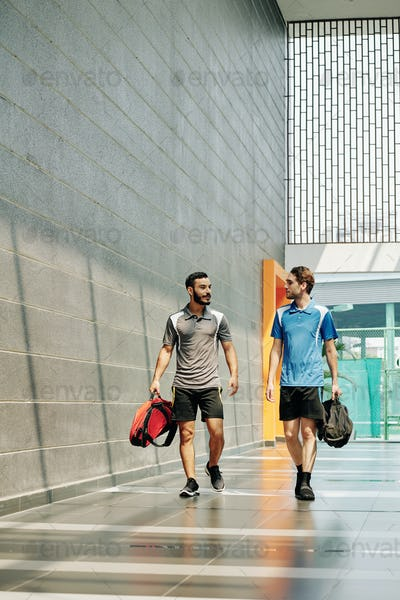 Young sportsmen walking to gym