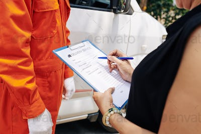 Woman filling delivery service document