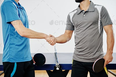 Ping pong players shaking hands