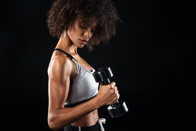 Image of african american sportswoman doing exercise with dumbbell