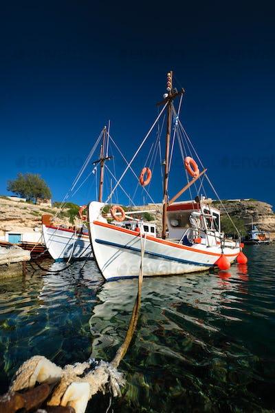 Fishing boars in harbour in fishing village of Mandrakia, Milos island, Greece
