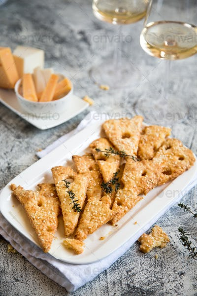 Homemade cheese baked cookies like cheese on a white plate