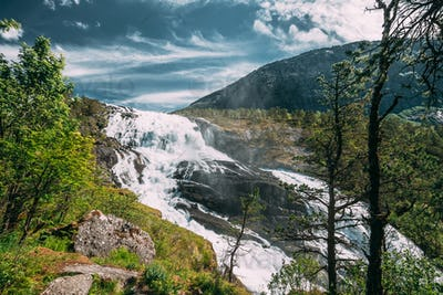 Kinsarvik, Hordaland, Norway. Waterfall Nyastolfossen In Hardangervidda Mountain Plateau