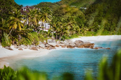Famous Anse Intendance beach surrounded by green tropical foliage, Mahe, Seychelles