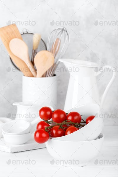 Kitchen table with white utensils
