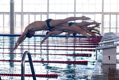 Swimmers plunging in the pool