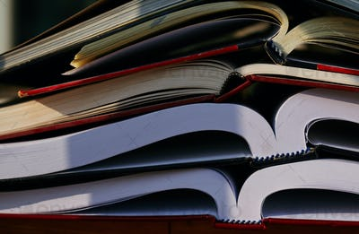 Close-up view of stacking book