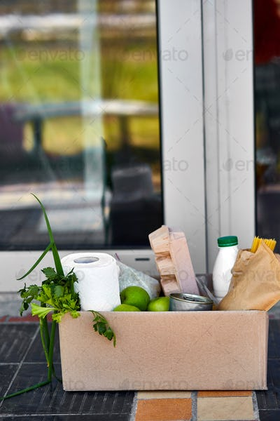 Delivery during the quarantine. Box with Merchandise, goods and food at door of home