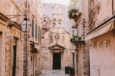 Old town street in Dubrovnik with view on church