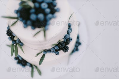 white wedding cake with blueberry and blackberry