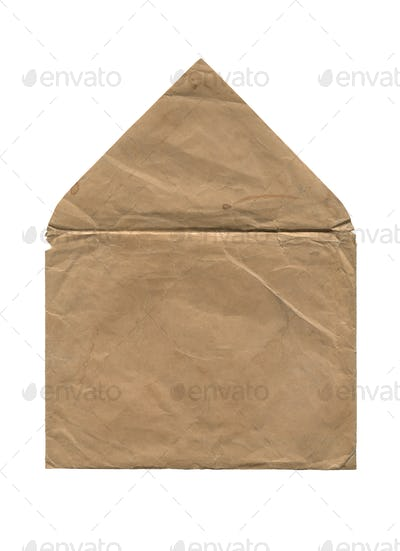 rear view of old open aged paper envelope isolated on white