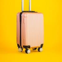 Pink color luggage or baggage bag use for transportation travel