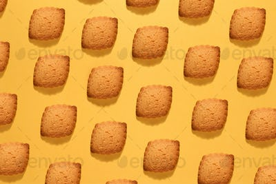 Baking still life of crunchy cookies on yellow