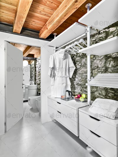 Interiors of the Modern Bathroom with Stone Wall