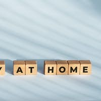 Stay at home phrase on wooden blocks