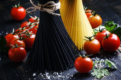 Spaghetti and tomatoes, still life in low key