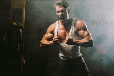 muscular man showing muscles sweaty and furious