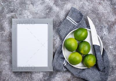 Fresh ripe limes on grey background