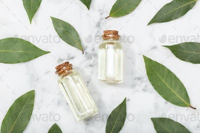 Bay laurel essential oil on marble table