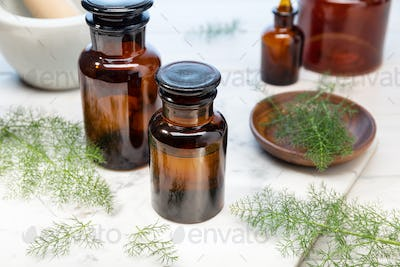 Fennel essential oil on amber bottles