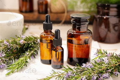 Rosemary essential oil on vintage apothecary bottles