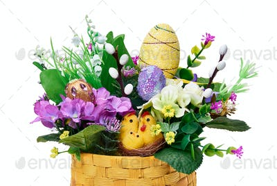 Easter basket from a flower arrangement and a hare on white background