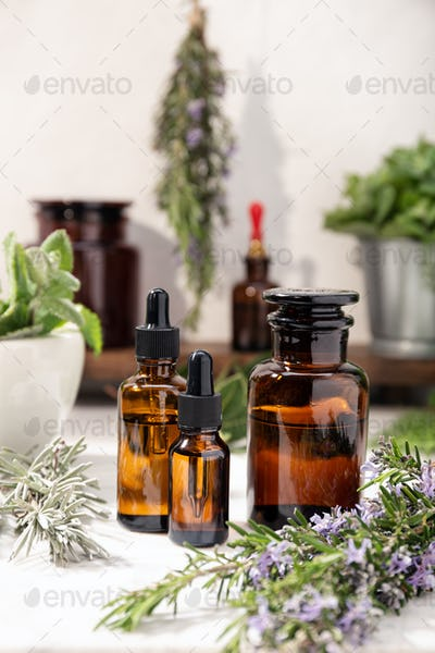 Herbal essential oil on amber glass bottles