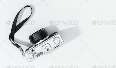 Flat lay film camera isolated on white background