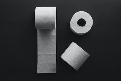 Toilet paper rolls on a black background