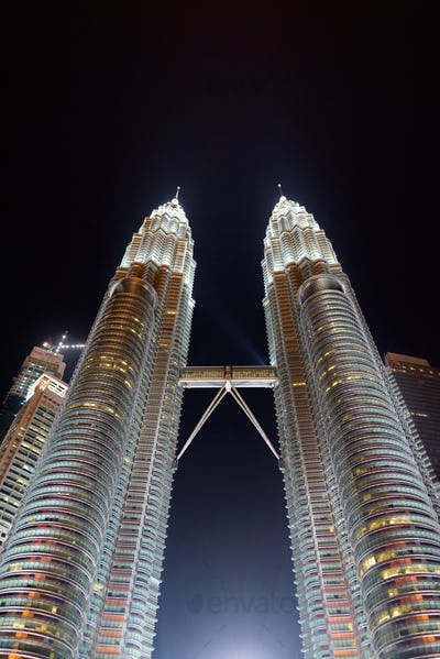 The Famous Petronas Towers At Night In Kuala Lumpur, Malaysia