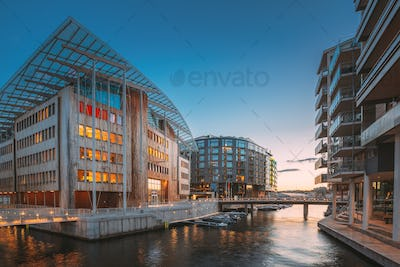 Oslo, Norway. Night View Embankment And Residential Multi-storey Houses In Aker Brygge District