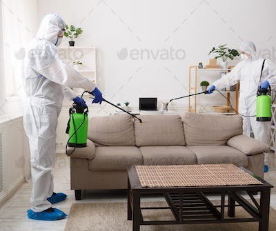 Workers in protective suits disinfecting with chemicals your flat