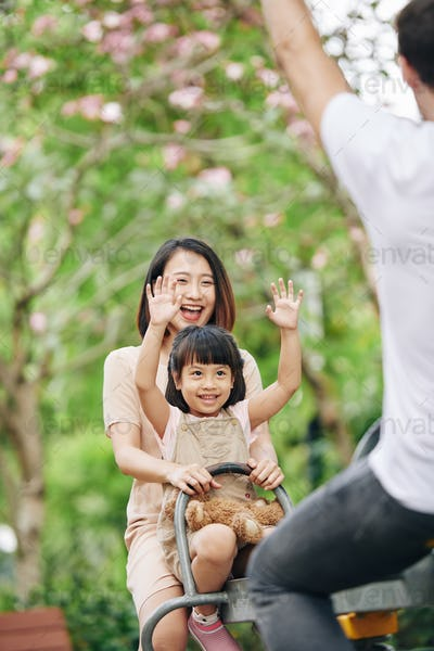Family spending time on playground