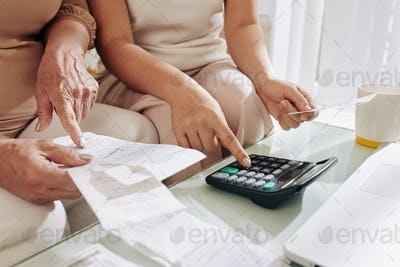 MOther and daughter checking unpaid bills