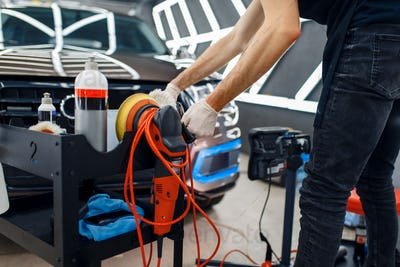 Worker, polishing machine and tools, car detailing