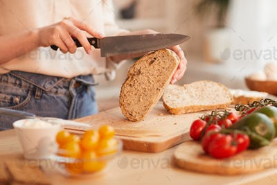 Woman Cutting Bread Close Up