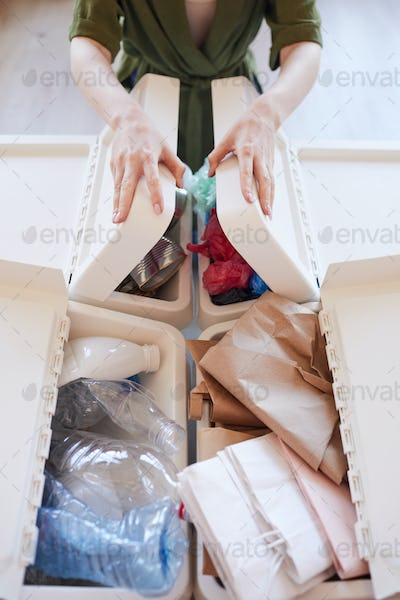 Unrecognizable Woman Sorting Waste at Home
